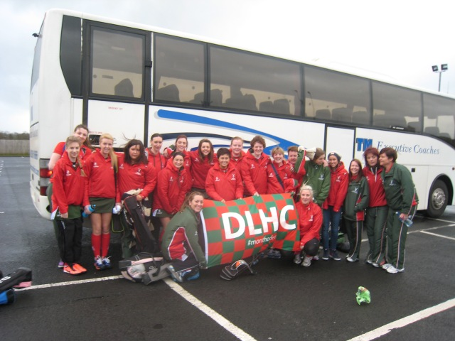 Donaghadee Ladies Hockey Club 1st and 2nd XIs unveil the new DLHC tour fleg on the bus trip to Coleraine