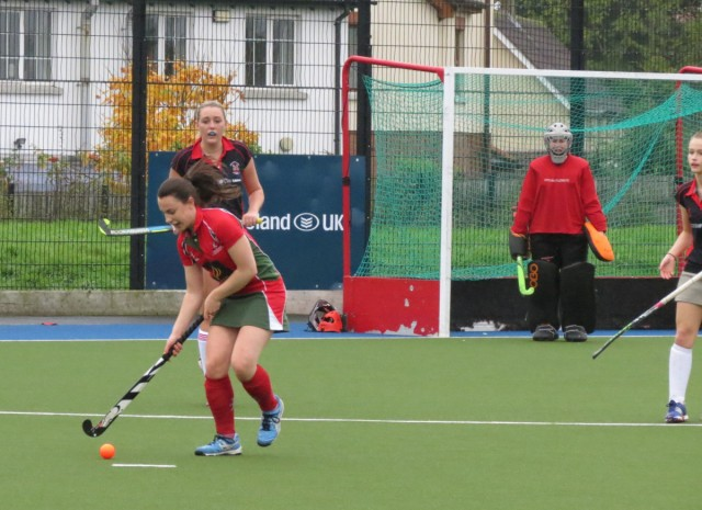DLHC 1XI midfielder Helen Hooks drives forward