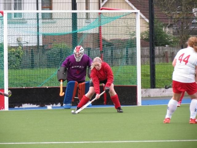 Defender Nina Wells bravely deflects a shot wide